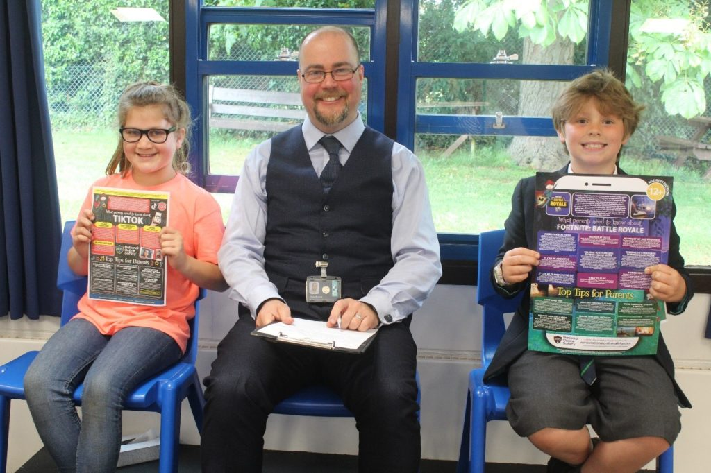 King's Ely Digital Leaders pose with posters